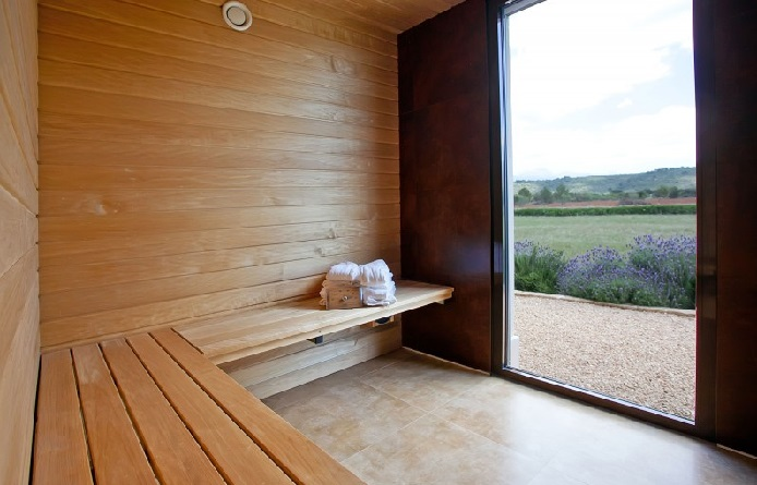 Inspiring-home-design-with-wooden-bench-and-wall-also-ceramic-floor-for-sauna-space